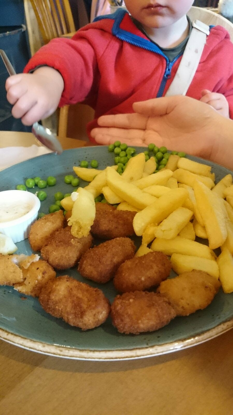 My Scampi & Chips being tucked into buy the boy